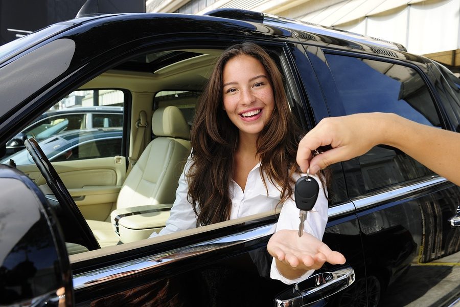 businesswoman receiving keys after upgrading car
